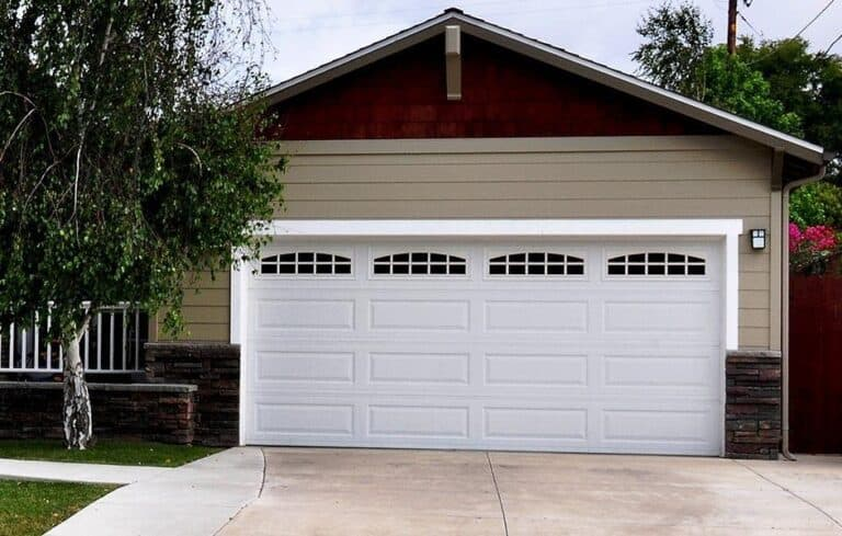 Garage Door: Replacing a Section vs. Replacing the Whole Door